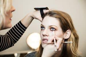 eyeliner application on female model