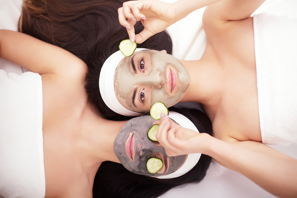 women getting cucumber facials