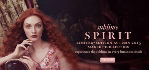 red haired woman posing on lounge chair for sublime spirit autumn makeup collection
