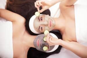 women getting cucumber facials
