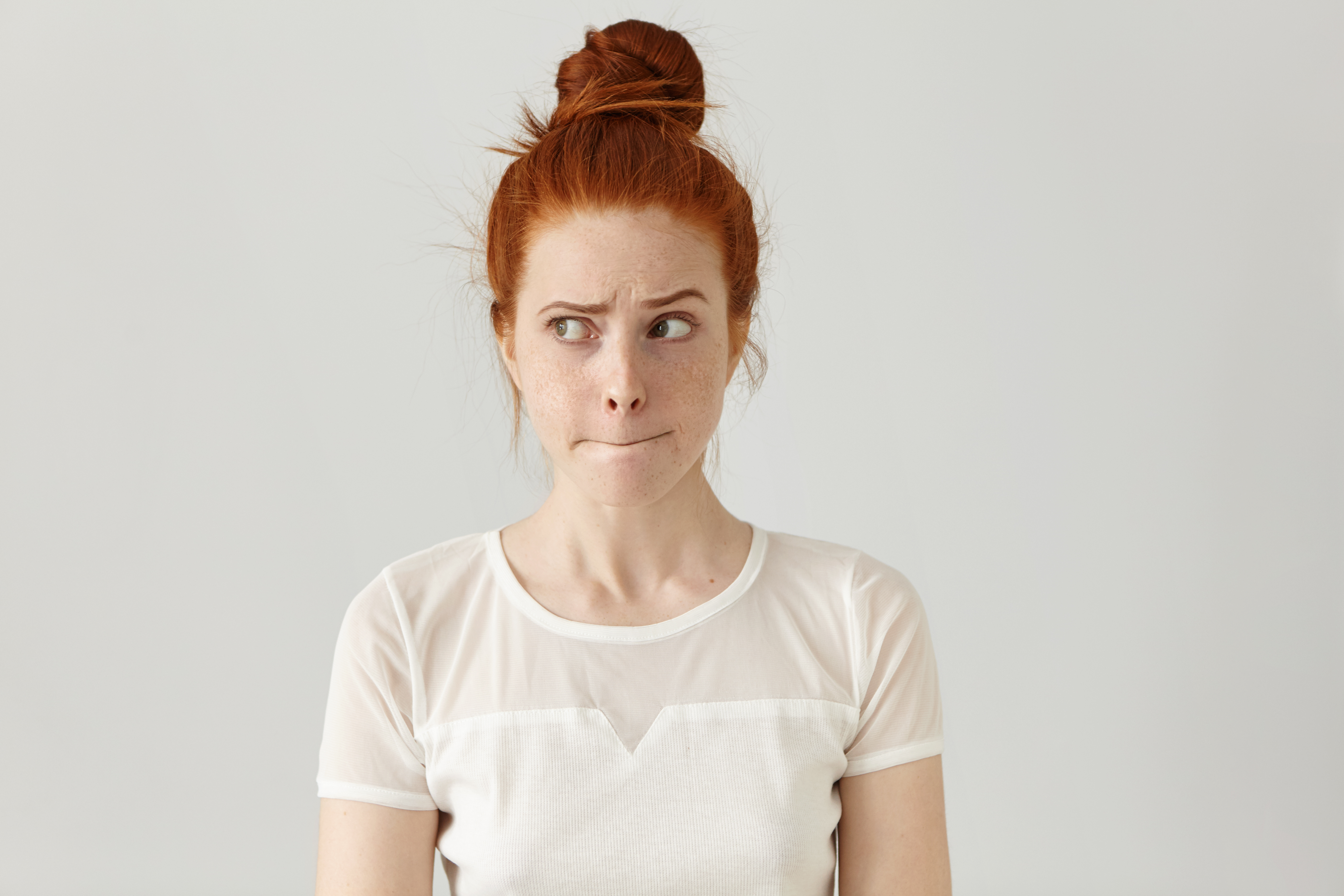 redhead with hair in bun