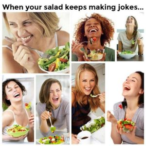 women smiling with salad