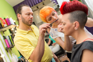 People learning hair and makeup in beauty school