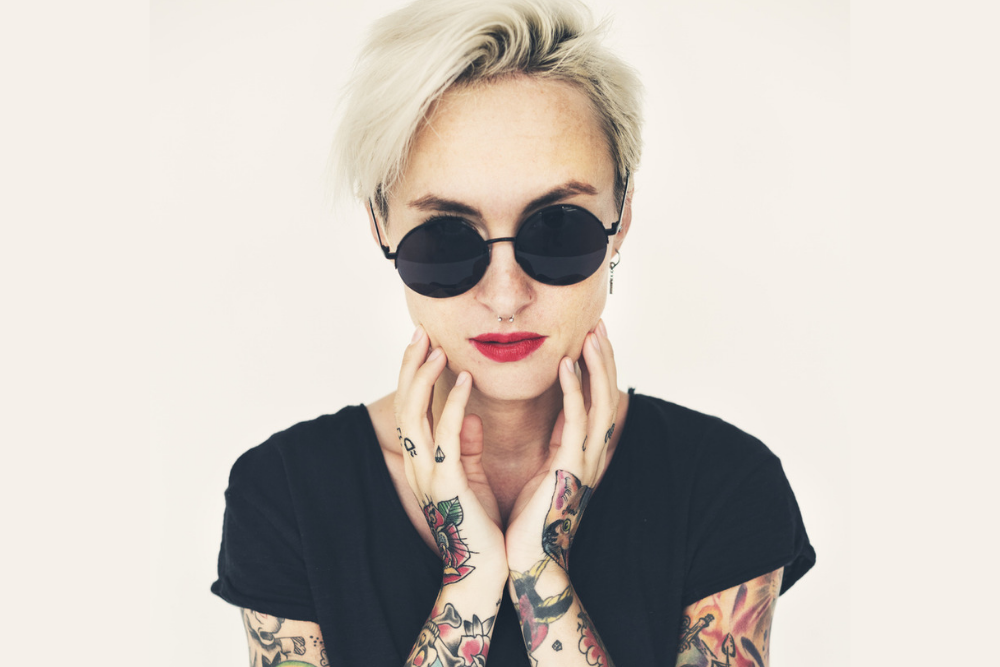 woman with sunglasses and tattoos