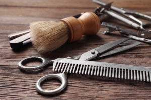 barbering tools on a wood table