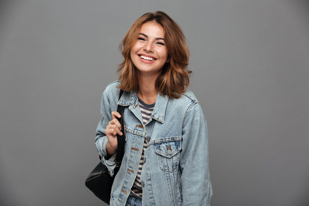 girl with jean jacket smiling