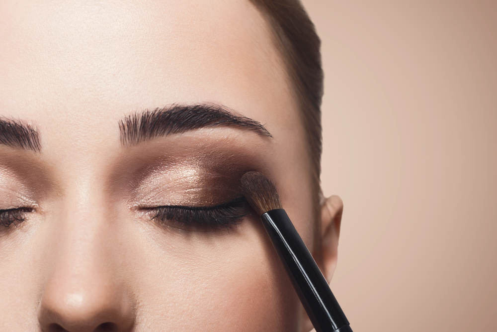 woman's face having dark eyeshadow applied