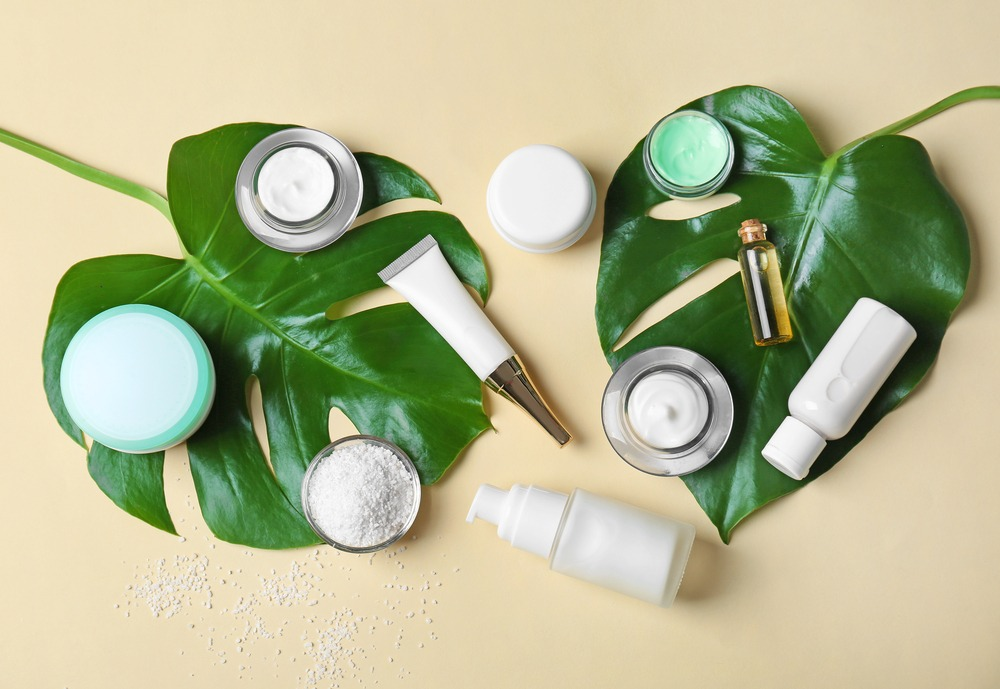 skin care products resting on leaf