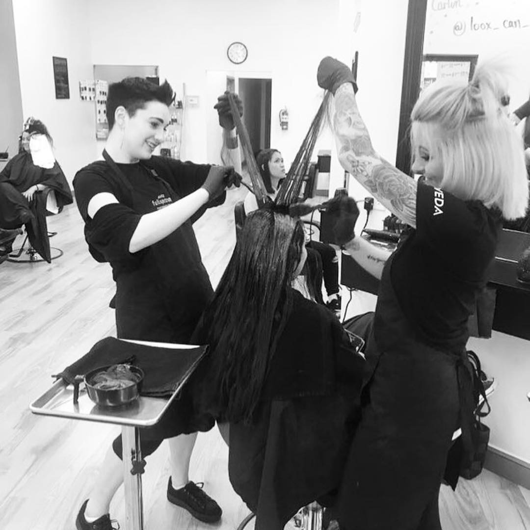 Aveda students working with client