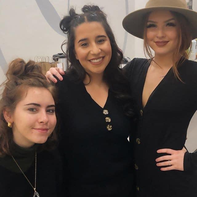 three students smiling at the camera